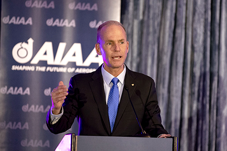 Boeing CEO Dennis Muilenburg delivers remarks at the 2019 AIAA Fellows Dinner