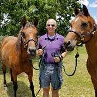 John-Valasek-with-his-horses