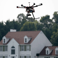 Drone_Over_Neighborhood2_AP_Purchased-200